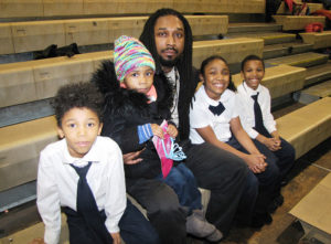 After School Counselor Leiron Flournoy, center, pictured with four of his children, from left, Kyzir, 7, Kearstin, 4, Kyler, 9, and Jyzir, 7.