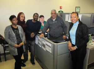 Director Joann Williams-Swiney, far right, with volunteers, from left, Star Gerald, Tahira Rivers, Brad Manuel, Anne Moran and Rashid Karriem.