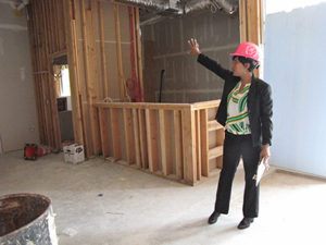 New Community Environmental Services Project Manager Ronda Lawrence shows off the reception area for A Better Life, which has begun to take shape.