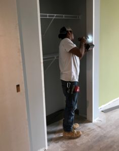Closet doors being installed in a unit of A Better Life.