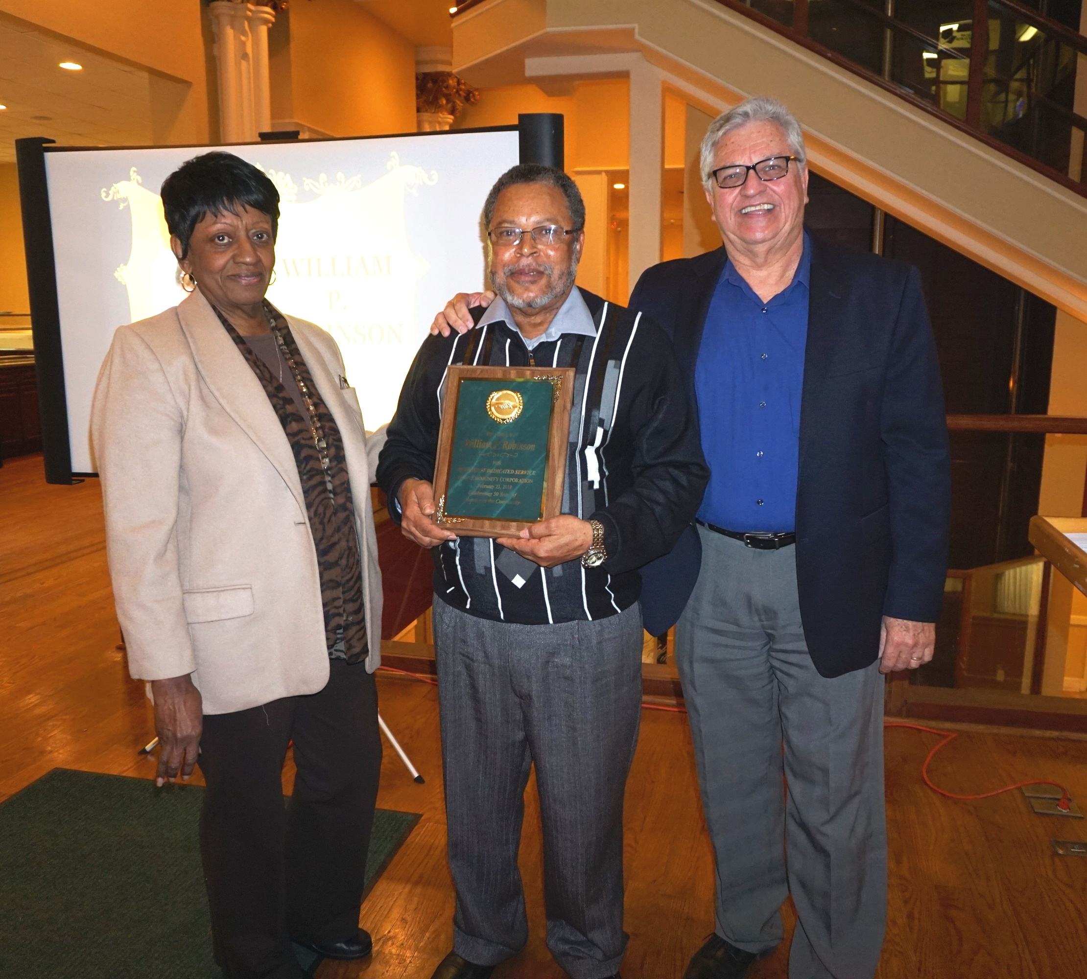Employees Recognized For Commitment To New Community