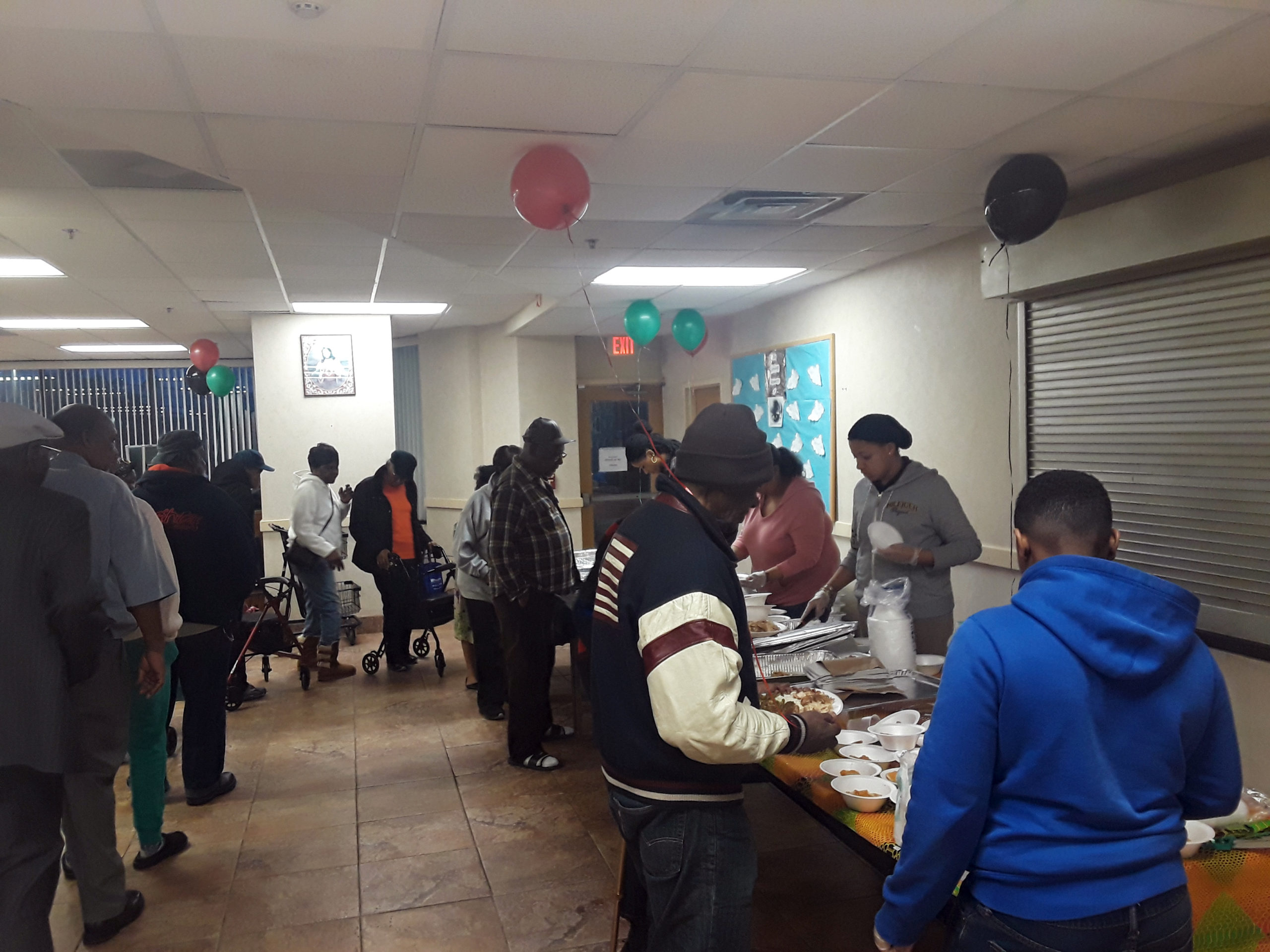 Associates Black History Dinner Getting Food
