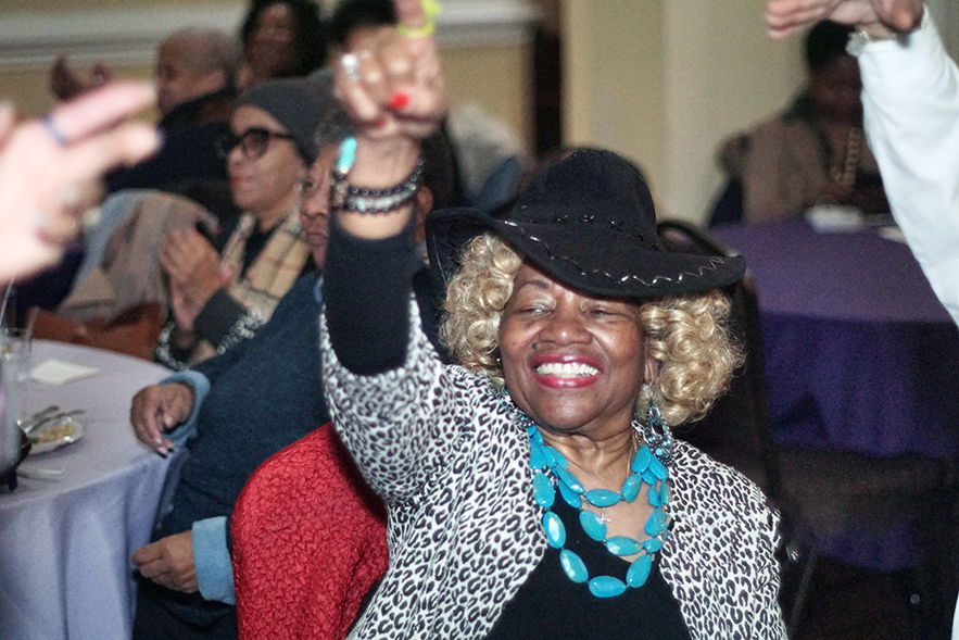 Women's History Celebration Audience Member Smiling for Website