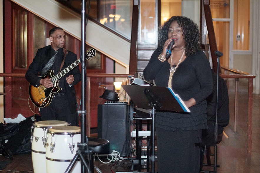 Women's History Celebration Woman in Black Singing with Band for Website
