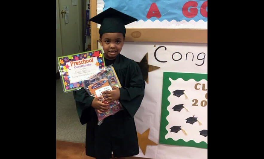 HHELC Graduation 2020 Boy with Supplies and Certificate Black Background