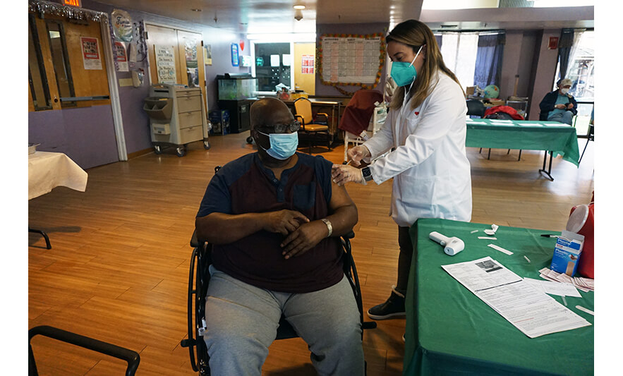 Extended Care COVID Vaccines 1-5-2021 Man in Wheelchair and Glasses for Website