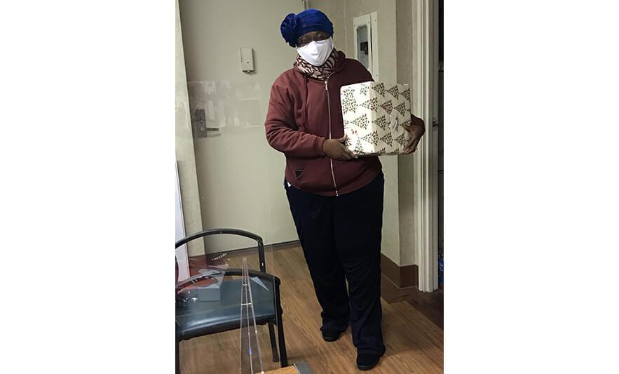 Roseville Senior Christmas Presents Woman for Website