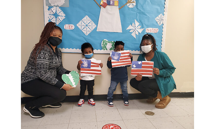 HHELC Black History Month 2021 Teachers and Kids with Made Flags for Web