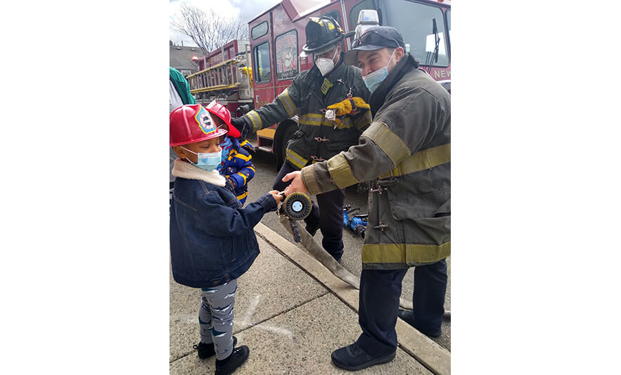 CHELC Fire Department Visit 4-16-2021 Boy Holding Hose for Web