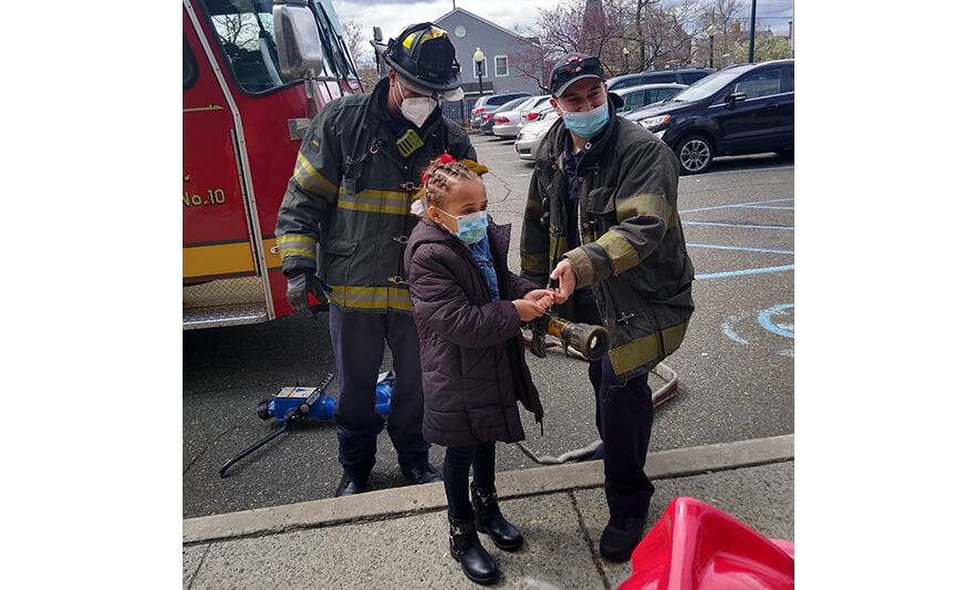 CHELC Fire Department Visit 4-16-2021 Girl Holding Hose for Web