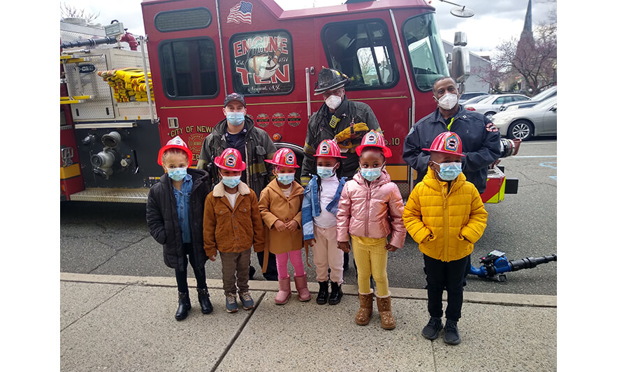 CHELC Fire Department Visit 4-16-2021 Group with Fire Hats for Web