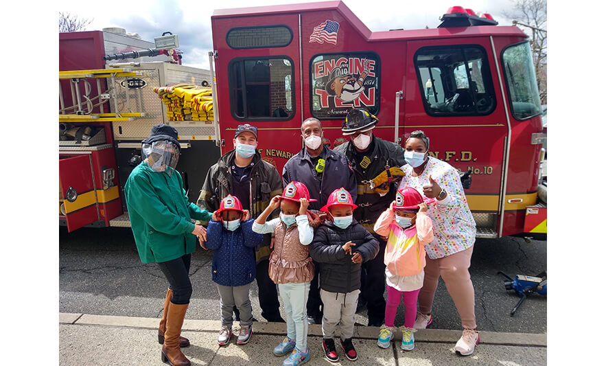 CHELC Fire Department Visit 4-16-2021 Smaller Group with Fire Hats for Web