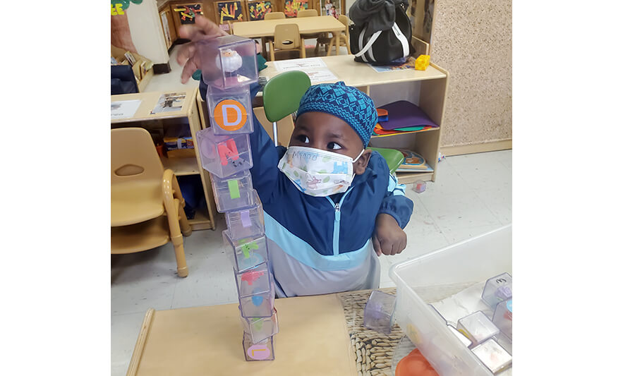 HHELC Week of the Young Child 2021 Boy Stacking Blocks for Web