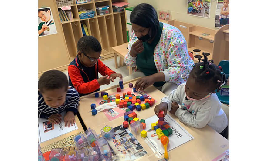 HHELC Week of the Young Child 2021 Teacher Helping with Blocks for Web