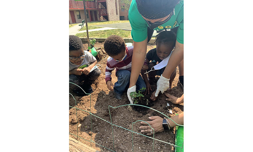 HHELC Gardening Day 5-26-2021 Planting with Three Students for Web
