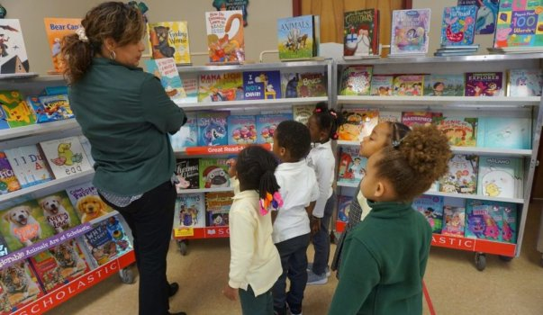 CHELC Book Fair Teacher Showing Book
